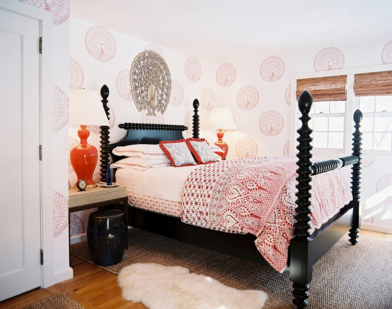 Eclectic bedroom with black wood spindle bed and orange accents [Design: Tilton Fenwick]