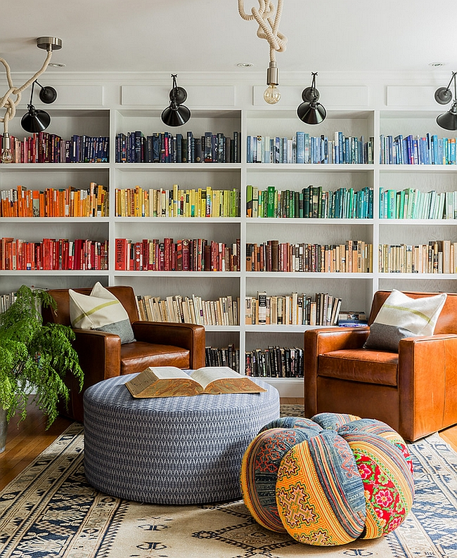 Eclectic family room with brilliant use of books [By: Hudson Interior Design]