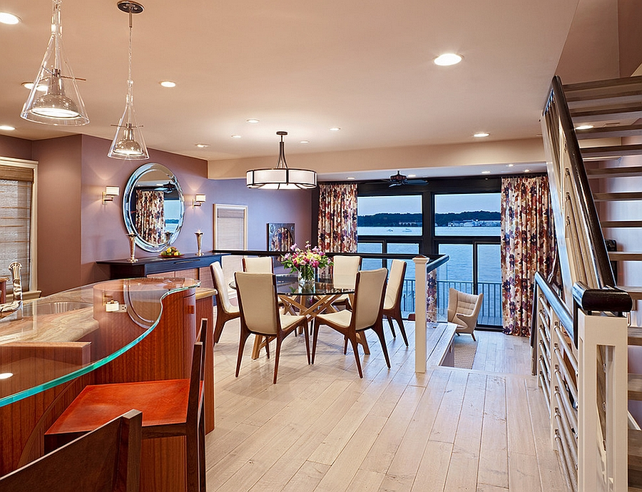 Elevated platform gives the dining space an unabated ocean view [From: Bruce Palmer Interior Design]