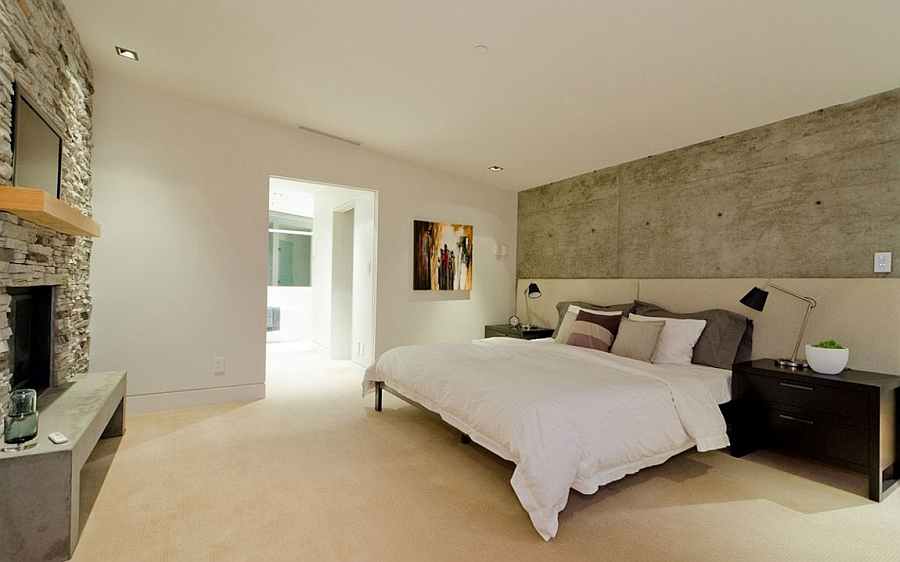 Exposed concrete brings a raw appeal to the cozy bedroom
