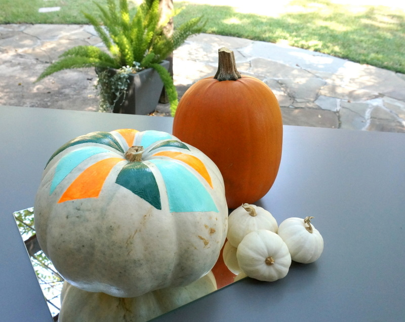 Fall table filled with pumpkins