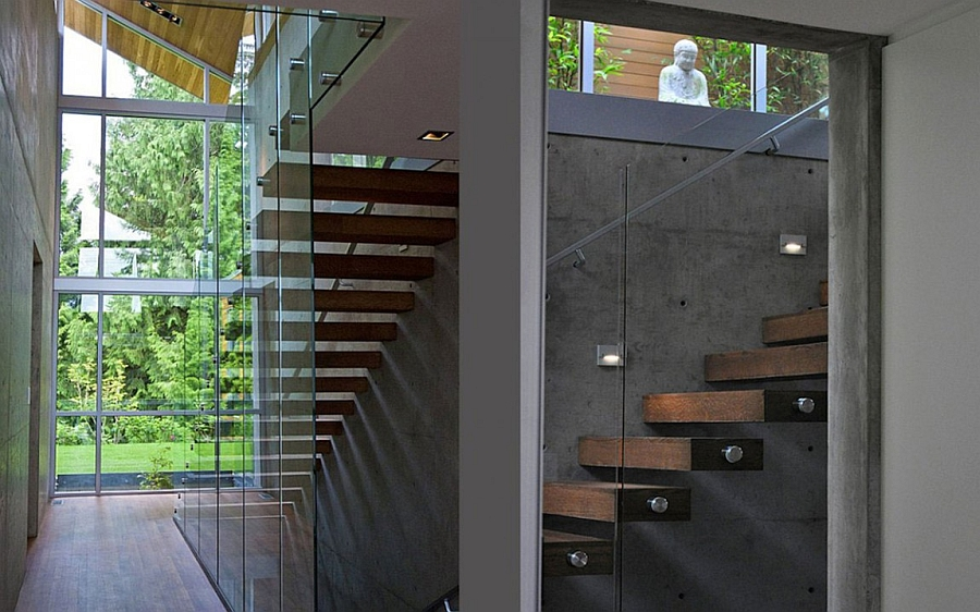Floating staircase with glass railing leading to the bedrooms