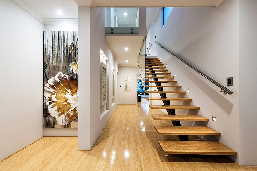 Floating wooden staircase leading to the top level