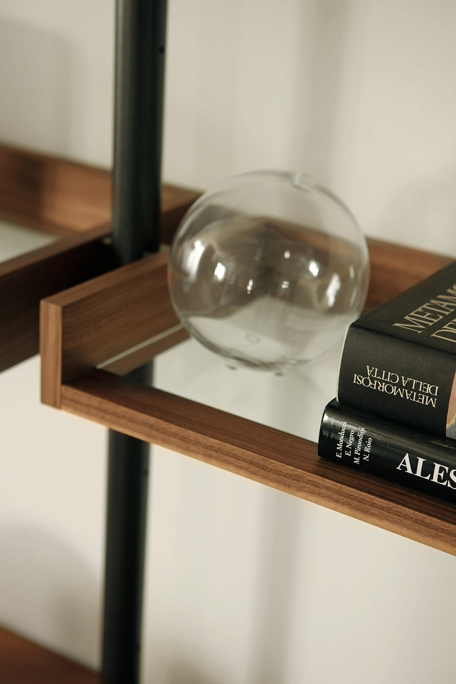 Glass lends lightness to the posh wall shelf unit