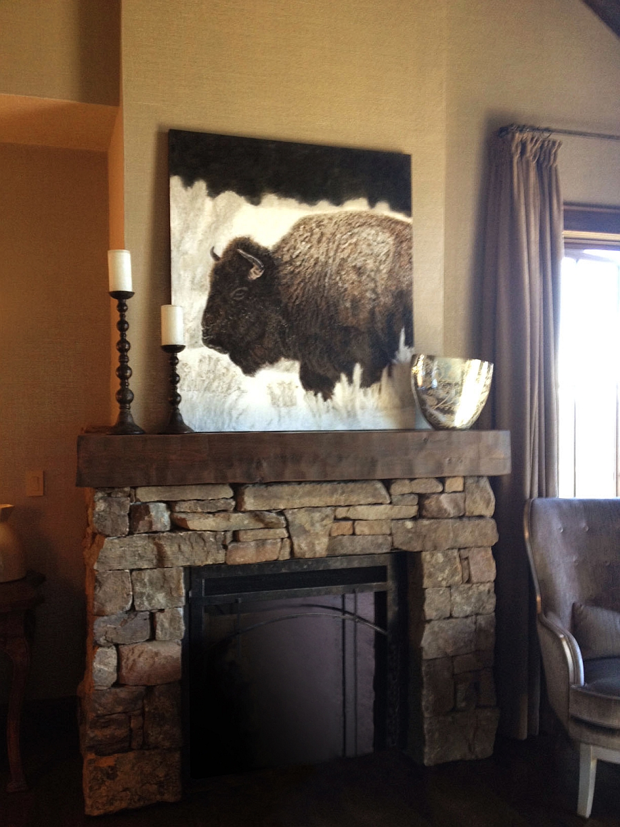 Goregous art work above the fireplace steals the show