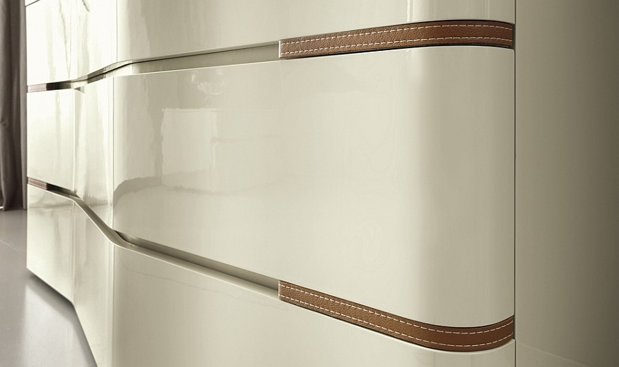 Gorgeous bedroom chest with sinuous shape and ecoleather inserts