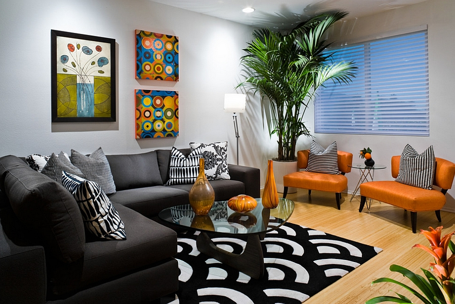 Gorgeous fusion of black and orange with bright pops of blue [By: Michelle Harrison Design]