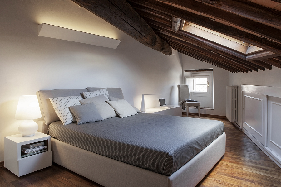 Smart renovation of historic italian apartment contemporary style Master bedroom with sloped ceiling