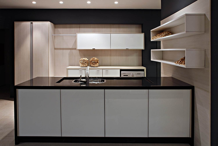Gorgeous modern kitchen with black countertop and golden accents