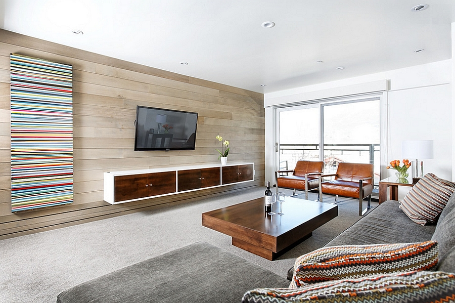 Grey stain riftsawn oak accent wall in the living room Contemporary Aspen Condo Gets A Chic Makeover