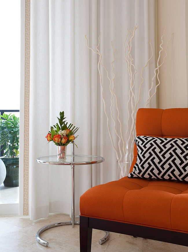 Infuse some orange zest into your bedroom with an orange accent chair [Design: NXG Studio]