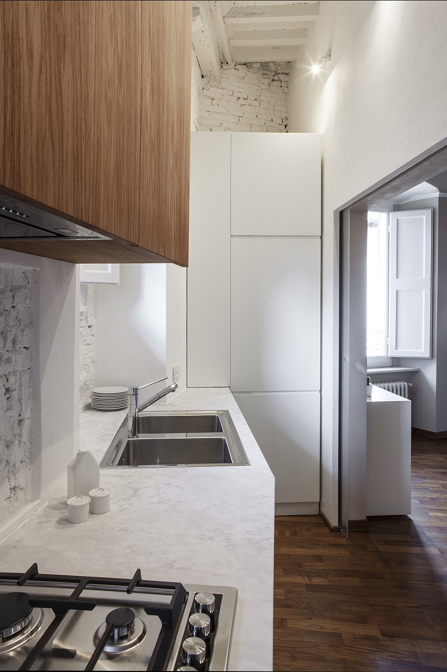 Innovative and compact kitchen utilizes available space to the hilt