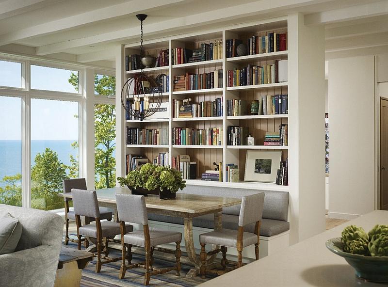 Interesting dining space design with a bookshelf [Design: Celeste Robbins]