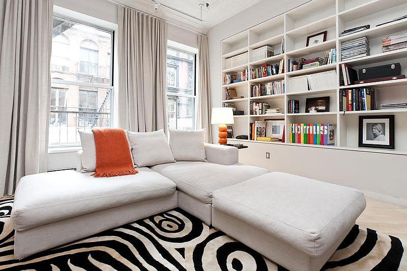 L-shaped white couch in the living room