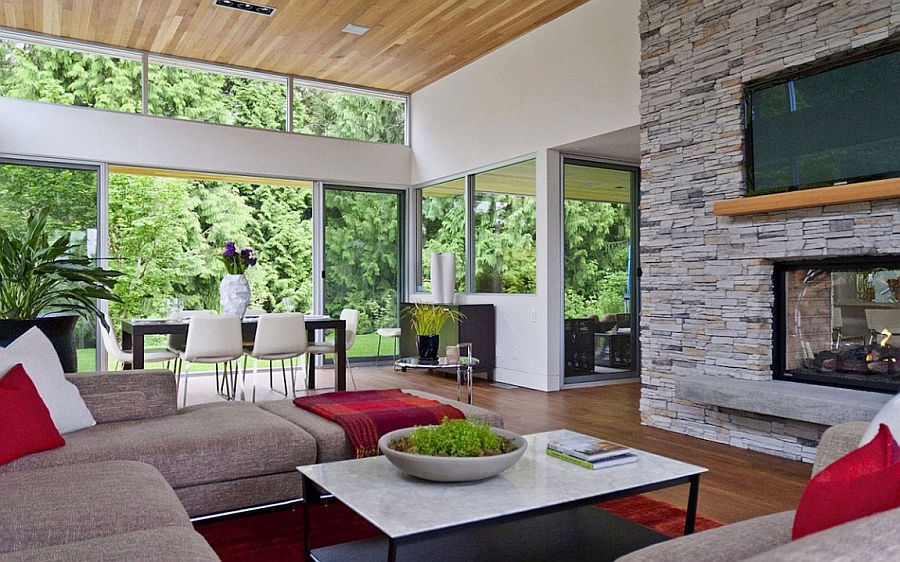 Large sliding glass doors bring the forest inside Tranquil Private Forest House In Vancouver Invites Nature Indoors
