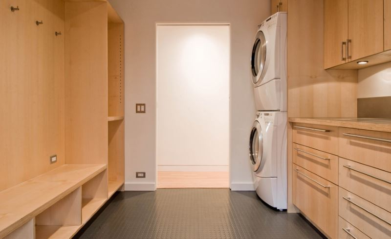 Laundry room with grey rubber flooring