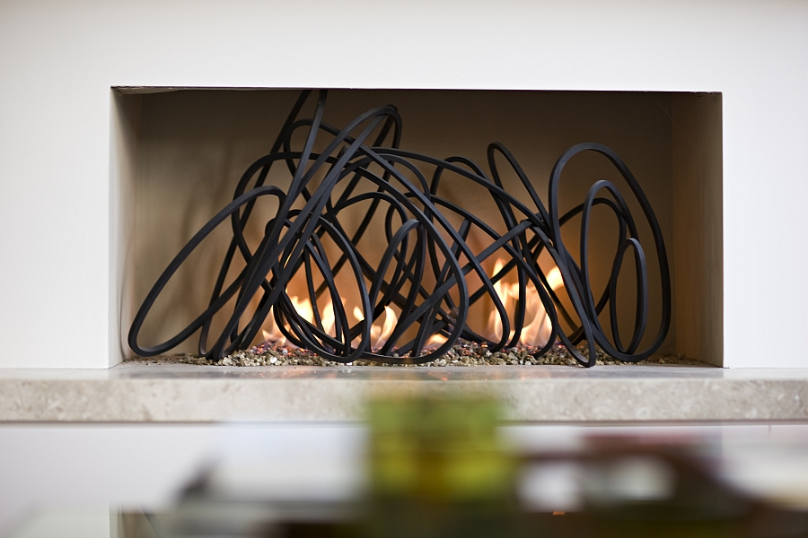 Lovely Loop Fireplace inspired by the rings of Saturn!