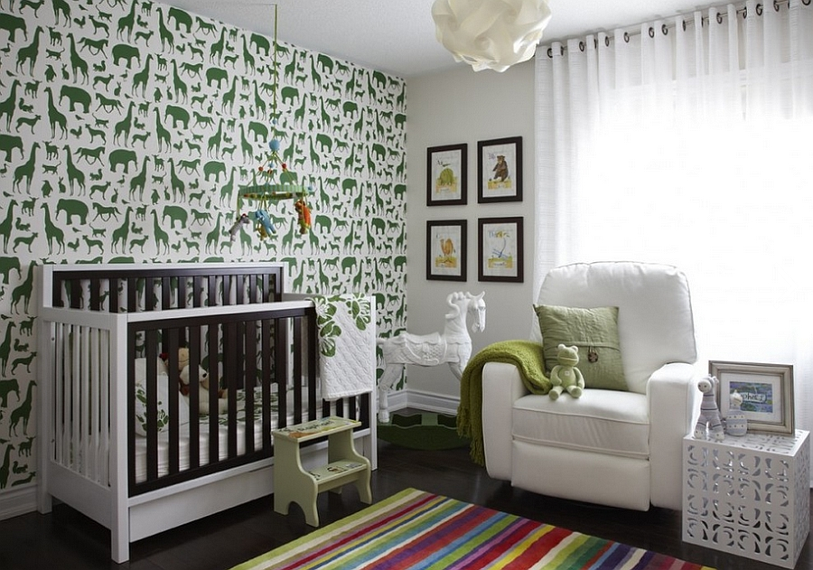 Lovely nursery room in green and white with animal prints on the wall [Design: Dvira - Interior Design Toronto]
