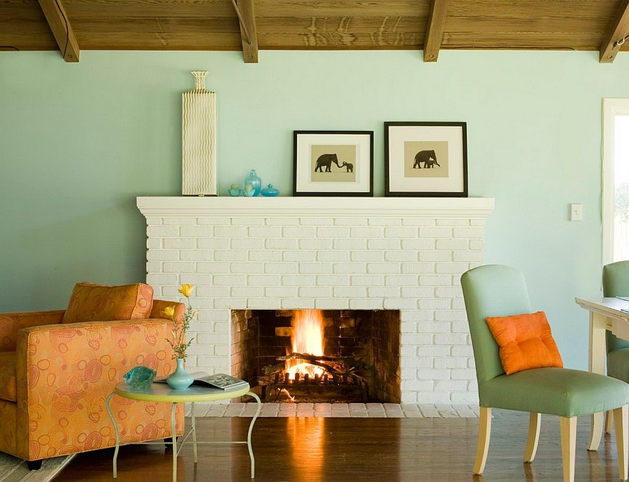 Lovely pops of color enliven the small living area [Design: Mark English Architects]