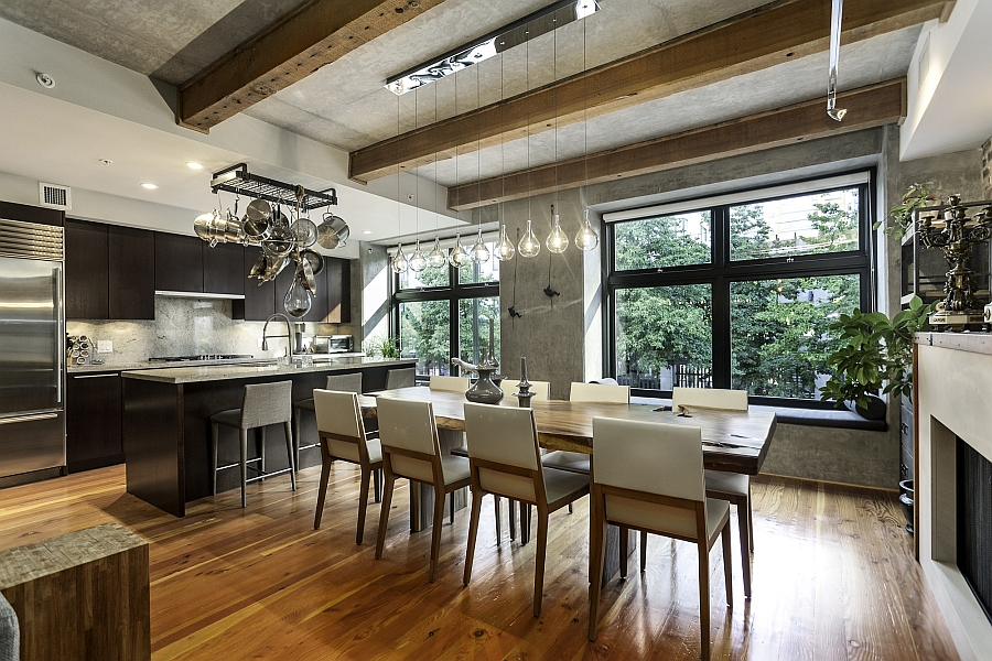 Lovely use of pendant lights in the kitchen and dining space