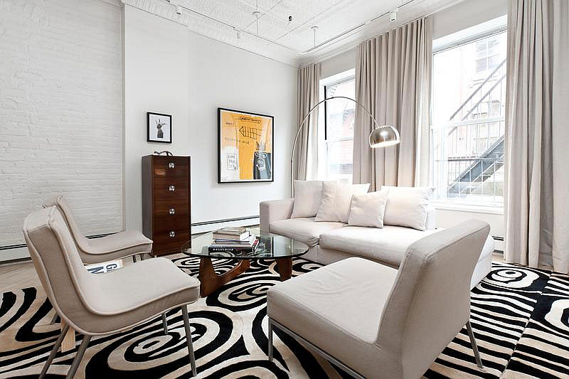 Lovely use of rug to add pattern to the room
