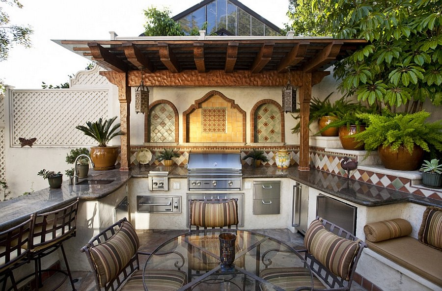 Mediterranean style outdoor space with a beautiful kitchen [Design: C & C Partners Design/Build]