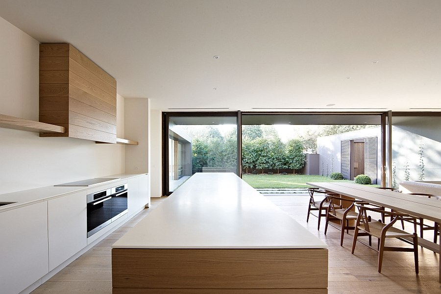 Minimal dining room and kitchen of the Bay House
