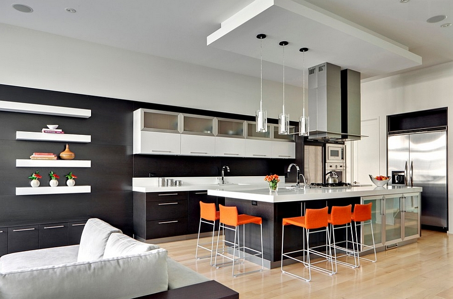 Minimalist kitchen with black with bright orange counter stools [By: MAY Designs]