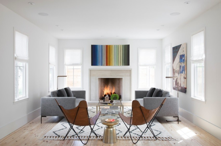 Modern art and a textured rug in a living room with a fireplace 10 Cozy Rooms With A Modern Fireplace