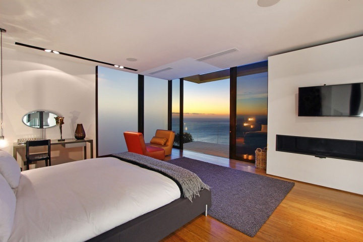 Modern guest bedroom with an ocean view