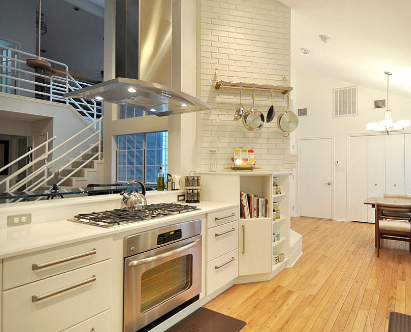 Modern kitchen with stainless steel pots