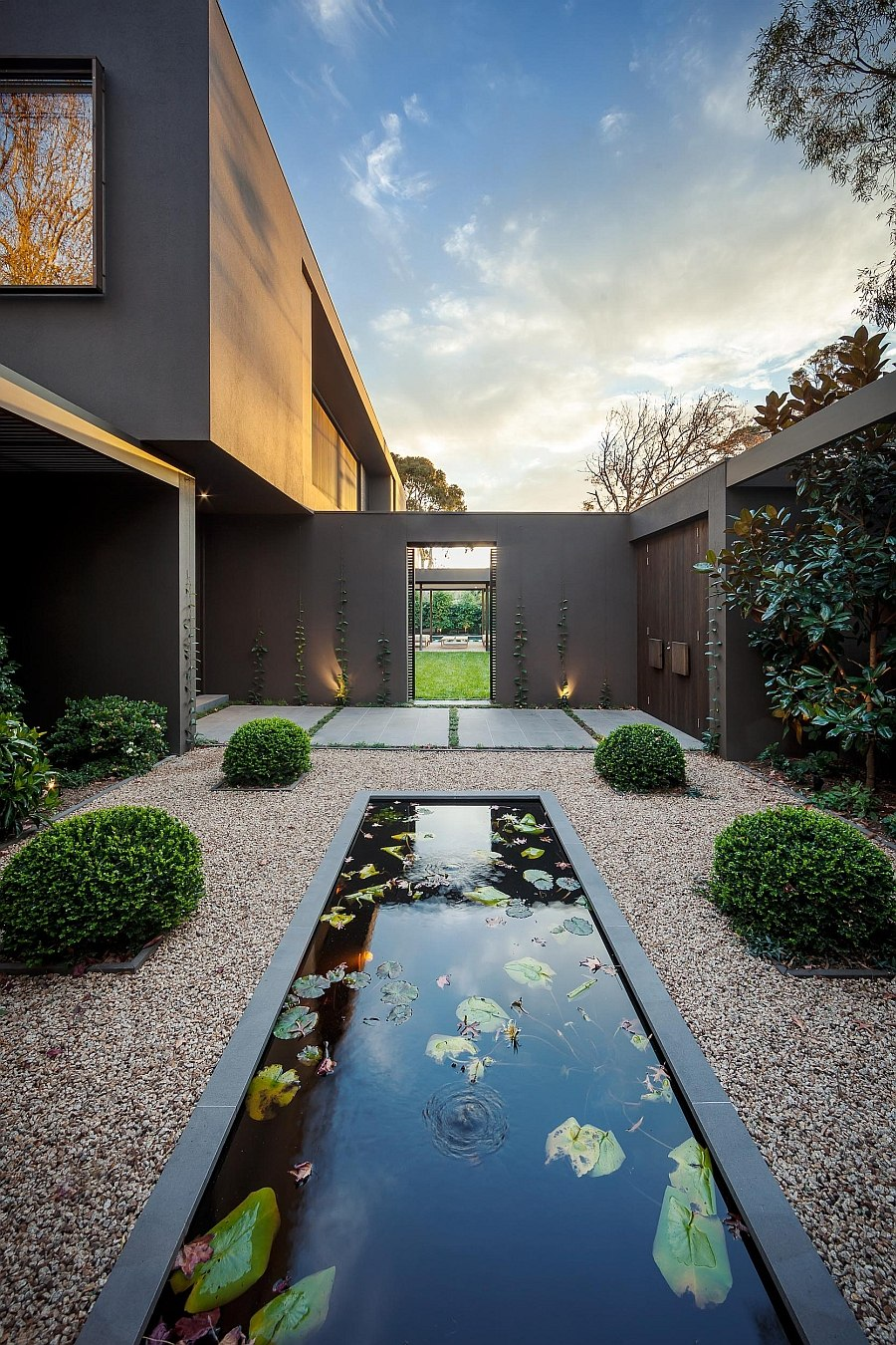 Modern landscape with a relaxing pond at its heart