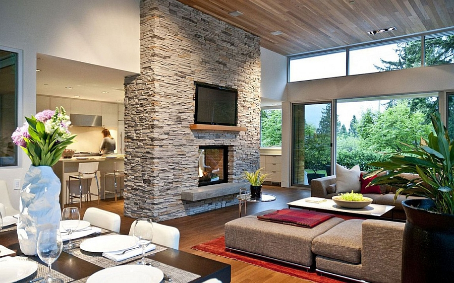 Open floor living area of the Forest House with a smart fireplace at its heart