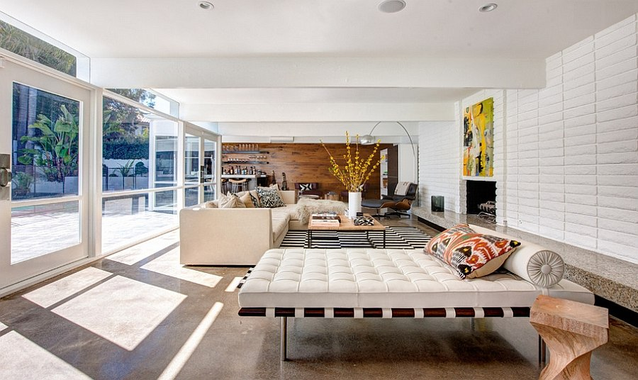 Open living room with a mid century modern style Two Story Mid Century Home Gets Fancy Remodel