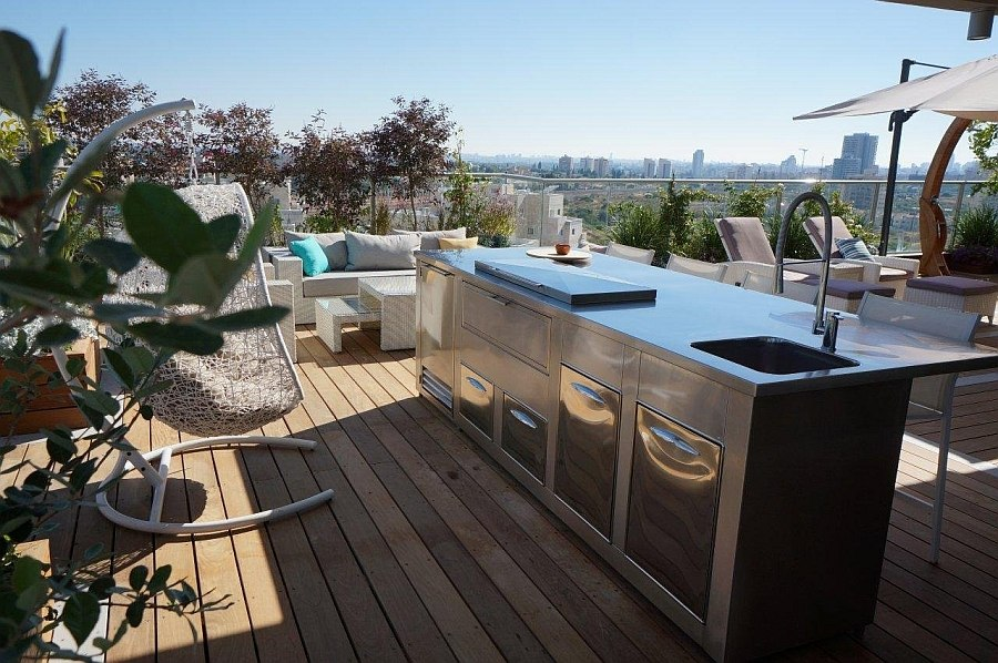 Outdoor kitchen on the terrace with stainless steel surface