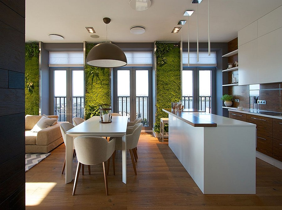 Accent green walls for a stylish apartment for Comedores industriales modernos