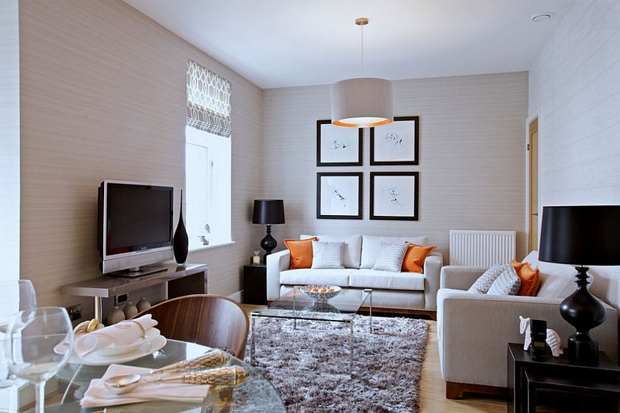 Pendant light adds subtle hint of orange to the living room [Design: The Couture Rooms]