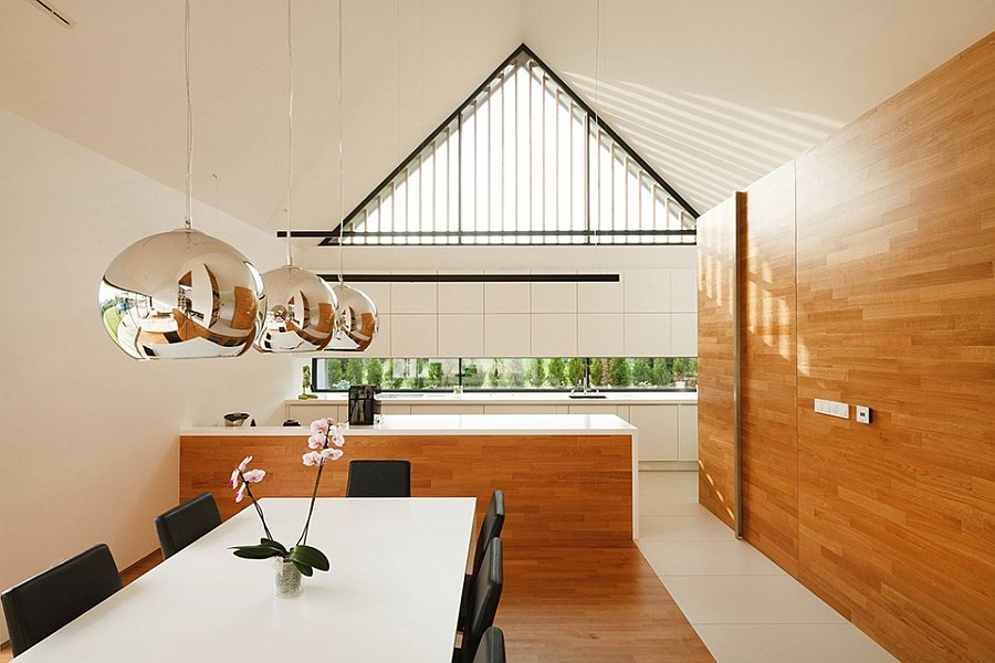 Pitched roof and airy interior give the home a grand appeal