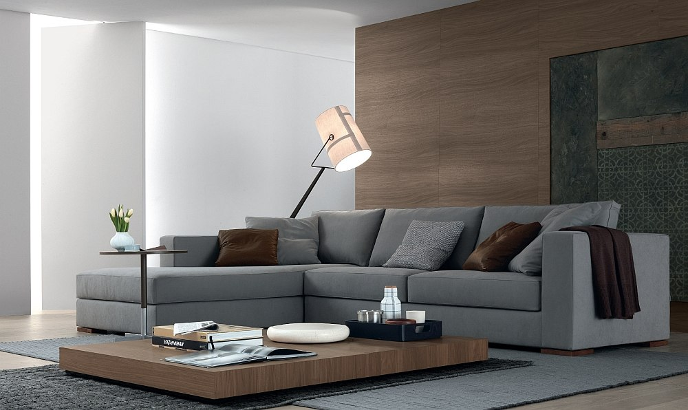 Plush grey sofa, low coffee table and floor lamp in the living room