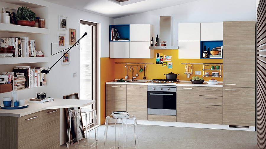Pops of royal blue and orange enliven the posh kitchen