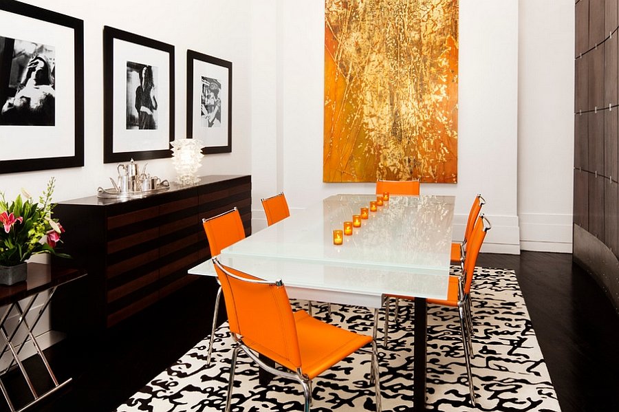 Posh dining room in orange, black and a hint of gold [By: Diego Alejandro Interior Design]