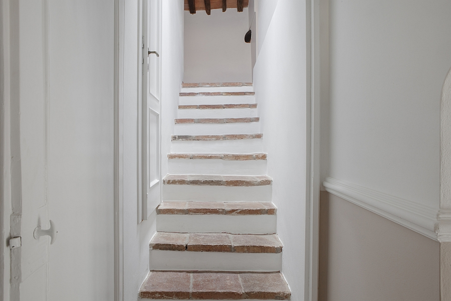 Private staircase leading to the master bedroom