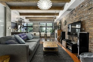 Raw concrete and exposed brick walls give the loft an eclectic appeal