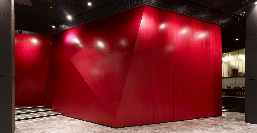 Red colored wood covered distorted structure inside Dogus Headquarters Creative Dogus Holding Headquarters In Istanbul With Dynamic Design