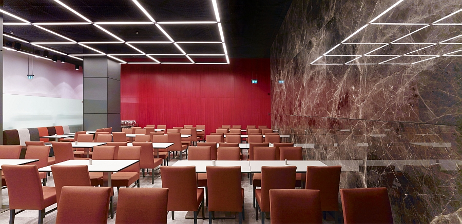 Red enlivens the dining and interaction space