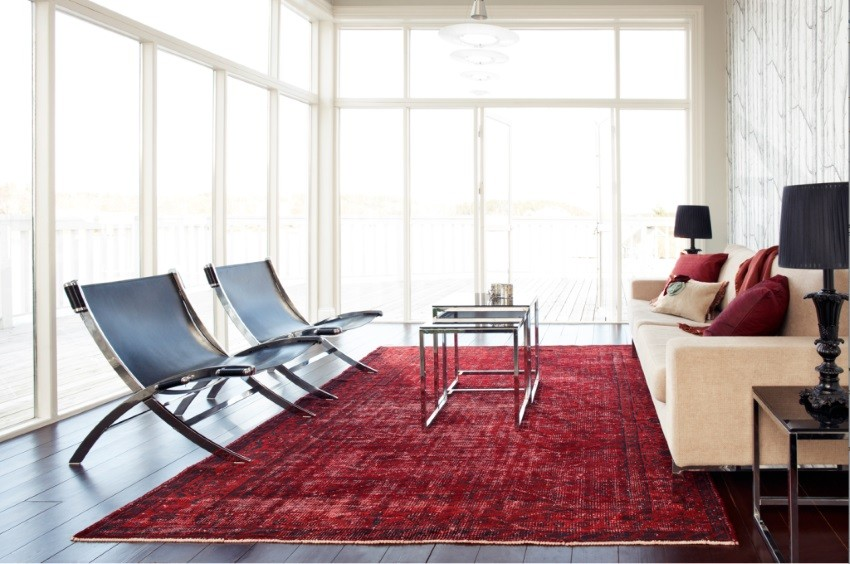 View in gallery Red overdyed rug in a modern living room