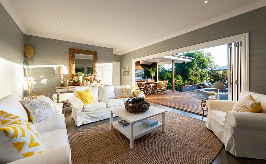 Refreshing beach style family room ensures its summer all year long! [Design: Acorn Garden Houses]
