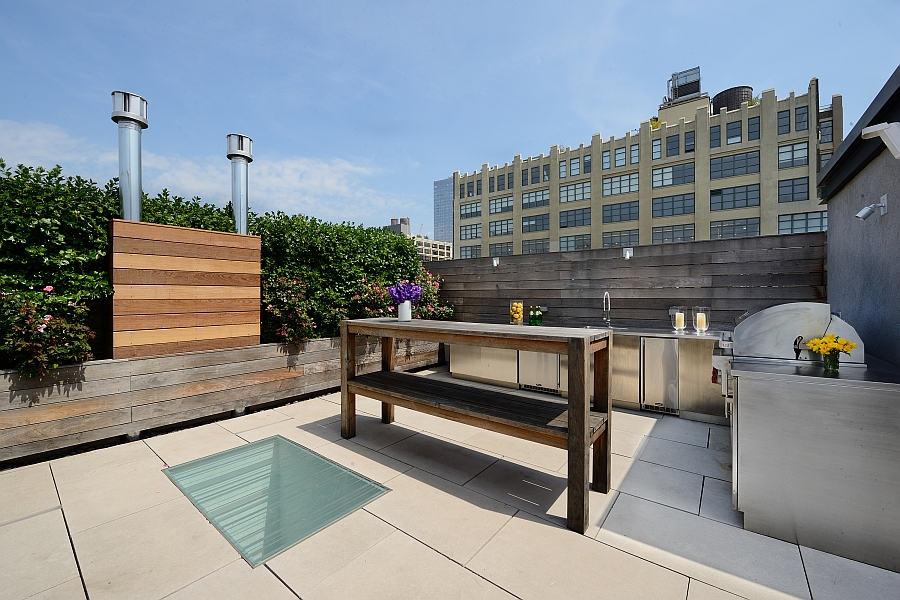 Rooftop lounge area with custom BBQ and full kitchen