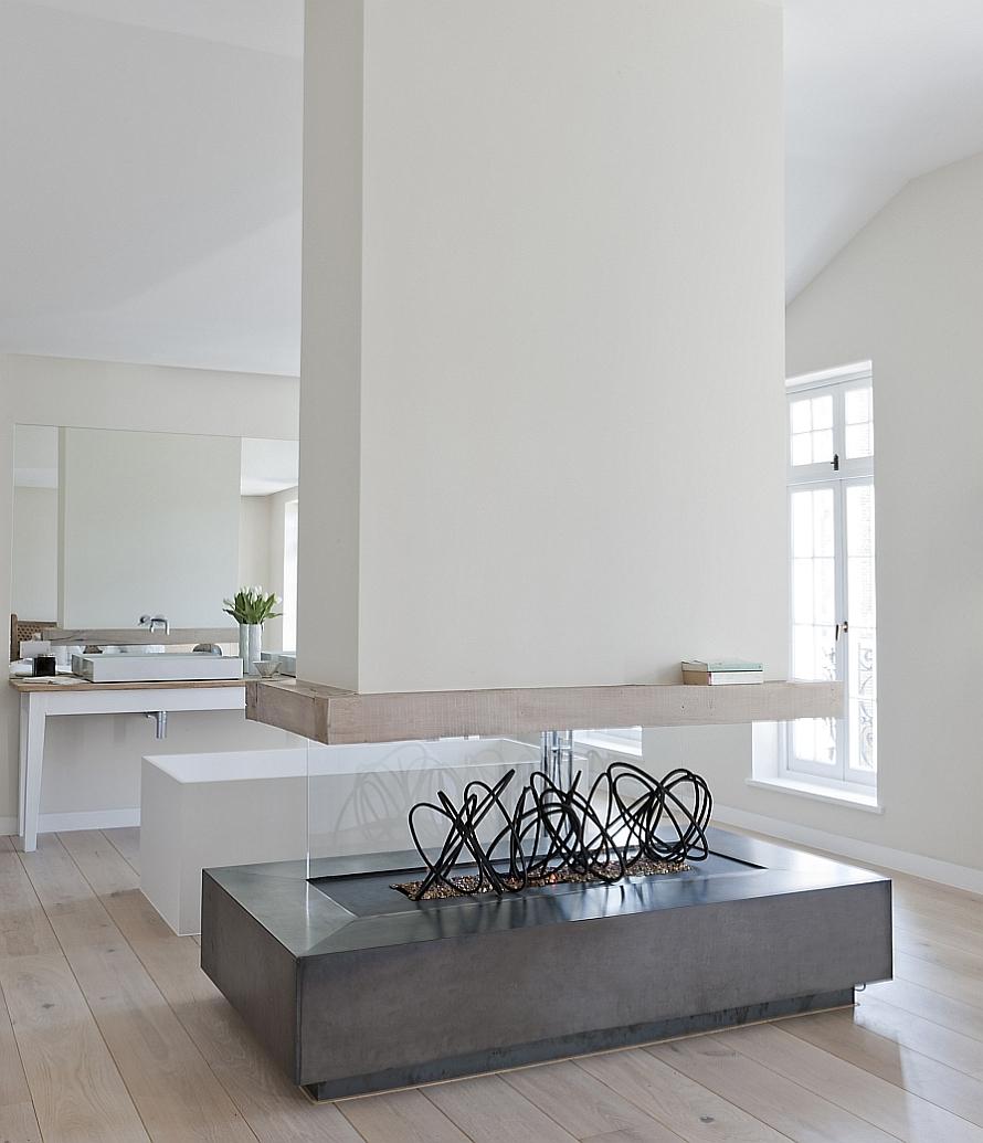 Sculptural fireplace in spa-like bathroom