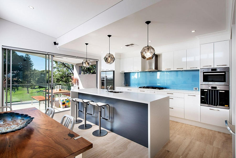 Sculptural pendant lights add unique style to the kitchen